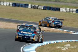 Jason Bargwanna follows team mate Mark Winterbottom through the chicane
