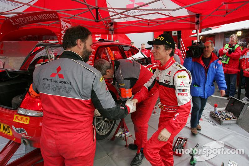 Gilles Panizzi celebrates third place finish