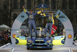 Podium: winners Petter Solberg and Phil Mills celebrate