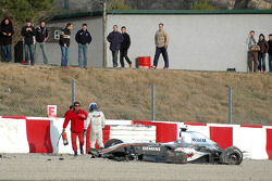 Kimi Raikkonen out of the car