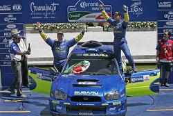 Podium: winners Petter Solberg and Phil Mills celebrate
