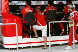Michael Schumacher watches the end of the race at pitwall