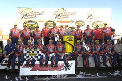 Race winner Jeff Gordon celebrates with his team