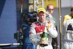 Podium: Tom Kristensen celebrates