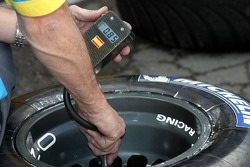 Michelin team member prepares tires