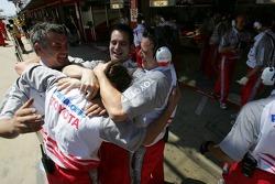 Toyota team members celebrates provisional pole position of Jarno Trulli