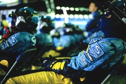 Renault F1 team members watch the race