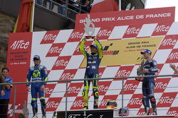 Podium: race winner Valentino Rossi with Sete Gibernau and Colin Edwards