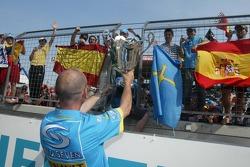 Fernando Alonso's fans are shown the winning trophy