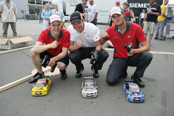 Mattias Ekström, Frank Stippler and Martin Tomczyk play with radio-controlled cars