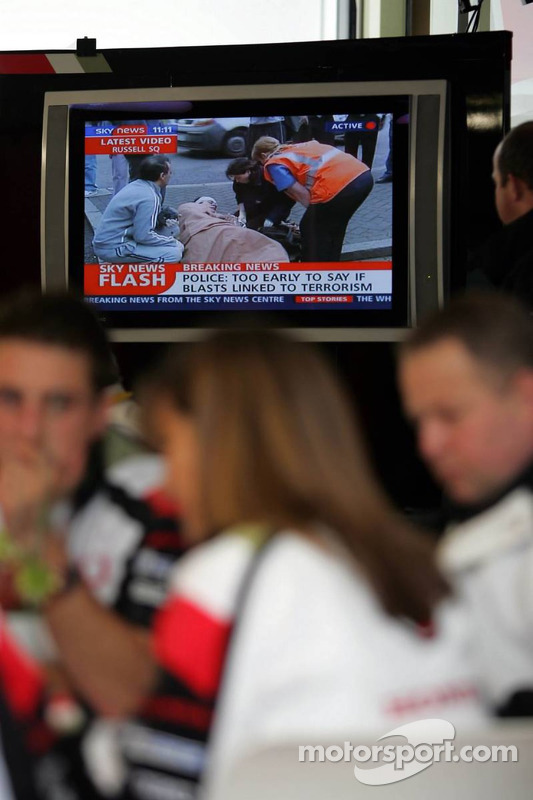 F1 paddock stops to watch the news on the bomb blasts in London