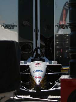 Car of Oriol Servia sits in paddock
