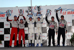 GT2 podium: class winnners Timo Bernhard and Romain Dumas, with Wolf Henzler and Mike Rockenfeller, and Johannes Van Overbeek and Jon Fogarty