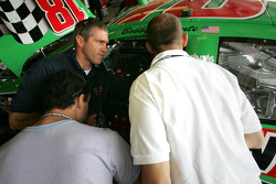 Bobby Labonte discusses with Grand-Am drivers Fabrizio Gollin and Matteo Bobbi