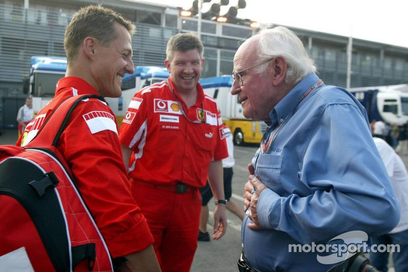 Michael Schumacher discusses with Prof Sid Watkins