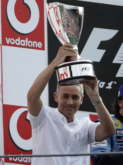 Podium: Martin Whitmarsh accepts constructors trophy