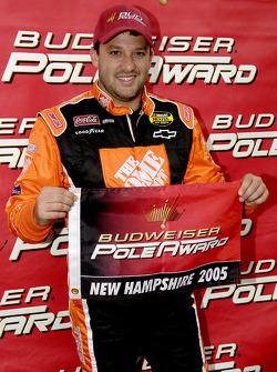 Pole winner Tony Stewart celebrates