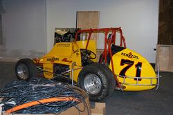 Al Unser, Jr.'s Nance sprint car sits amid the construction materials