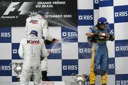 Podium: champagne for Juan Pablo Montoya, Kimi Raikkonen and Fernando Alonso