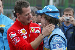 The passing of the crown: Michael Schumacher congratulates 2005 World Champion Fernando Alonso