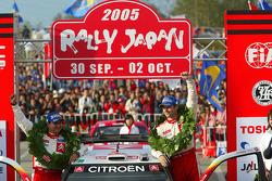 Podium: 2005 WRC champions Sébastien Loeb and Daniel Elena celebrate