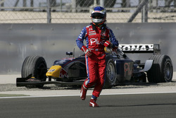 Heikki Kovalainen retires in the first lap after spinning out