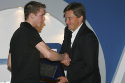 Scott Speed accepts his award for finishing third