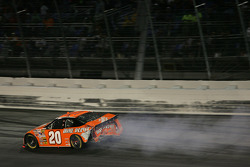 Tony Stewart cuts a tire and hits the wall
