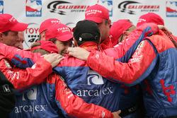 Race winner Dario Franchitti celebrates with his team