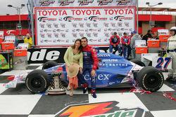Race winner Dario Franchitti celebrates with wife Ashley