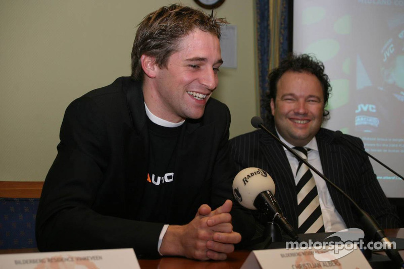 Christijan Albers answers questions from the members of the press during the press conference announcing that he will drive for Midland in 2006