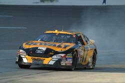 Matt Kenseth locks up the brakes coming on to the pit lane