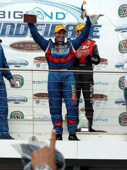 Podium: race winner Marcos Ambrose celebrates