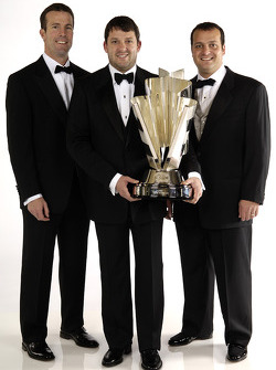 NASCAR Nextel Cup Awards Banquet at the Waldorf Astoria Hotel: Tony Stewart, the 2005 NASCAR Nextel Cup Series Champion, poses with his crew chief Greg Zipadelli and team owner J.D. Gibbs