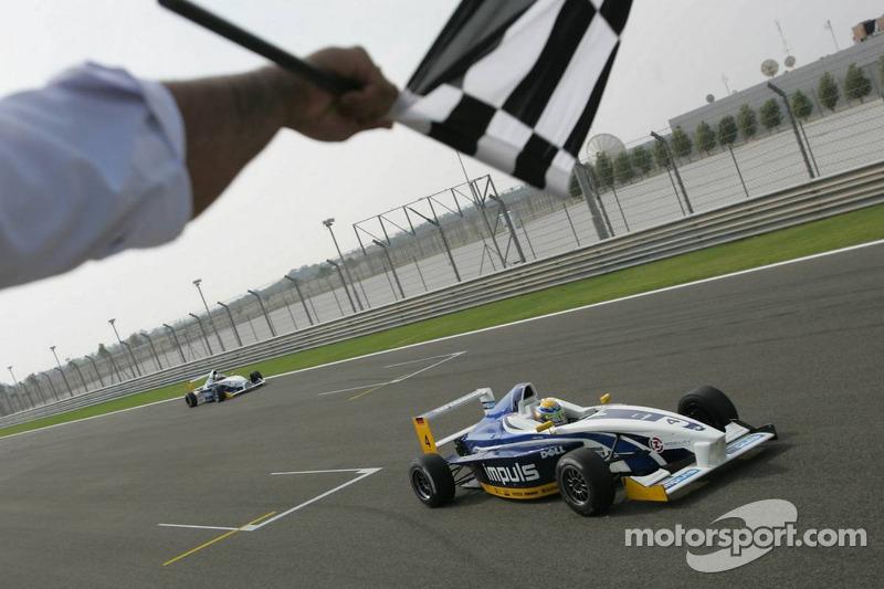 Marco Holzer takes the checkered flag