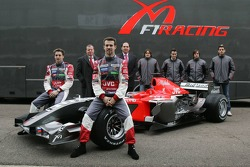 Christijan Albers, Tiago Monteiro, team owner Alex Schnaider, Commercial Director Colin Kolles, Markus Winkelhock, Roman Rusinov, Giorgio Mondini and Adrian Sutil pose with the new MF1 Racing M16