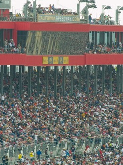 California Speedway control tower and skyboxes with race team radio spotters on the roof