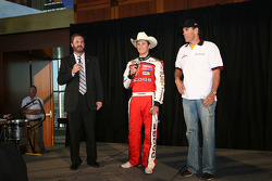 Eddie Gossage, Kasey Kahne and Ray Evernham attend a champagne toast after the race