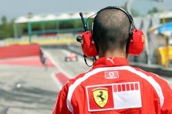 Ferrari mechanic waits for Marc Gene