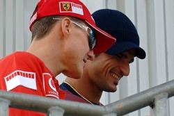 Michael Schumacher and Vitantonio Liuzzi