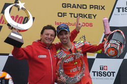 Podium: race winner Marco Melandri celebrates with Fausto Gresini