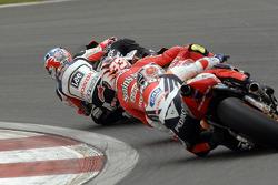 Casey Stoner, LCR Honda; Marco Melandri, Gresini Honda
