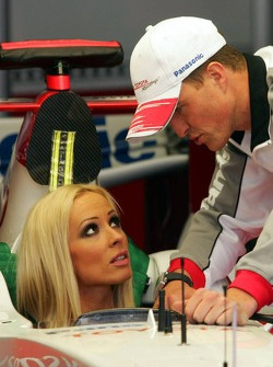 Cora Schumacher is instructed by Ralf Schumacher in the Toyota racing car