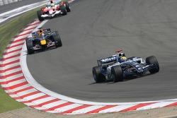 Mark Webber leads Christian Klien