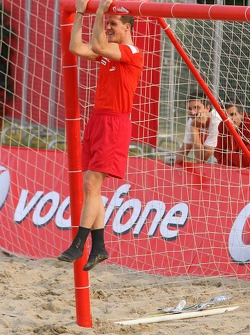 Vodafone Ferrari Beach Soccer Challenge: Michael Schumacher hangs from the cross bar