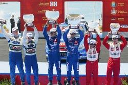 Podium: winners Sébastien Loeb and Daniel Elena, with second place Mikko Hirvonen and Jarmo Lehtinen, and third place Daniel Sordo and Marc Marti