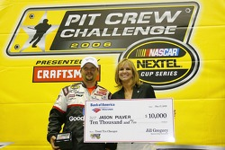 Jason Pulver receives a $10,000 check for being the top front tire changer in the NASCAR Nextel Pit Crew Challenge