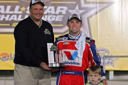 Scott Riggs poses with the trophy after winning the NASCAR Nextel Open