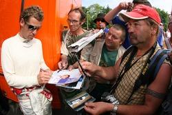 Tom Kristensen signs more autographs