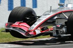 Juan Pablo Montoya lifts a wheel